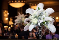 Tally Gatsby floral and feathers centerpiece #roaring20s