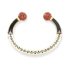 AN ART DECO IVORY, CORAL, DIAMOND AND ENAMEL SUDANESE BRACELET, BY CARTIER