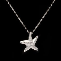 Tiffany & Co. Diamond Platinum Starfish Pendant Necklace from the Elsa Peretti Collection. The starfish is enhanced by 20 round cut diamonds for 0.13ct. The small pendant measures approximately 15mm and hangs on a 16 inch chain, weighing 6.2 grams. This piece is in the original Tiffany & Co. packaging.