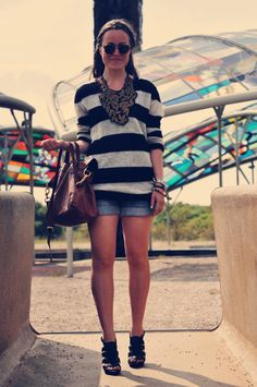 Love the big necklace with striped jumper