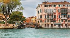View of ancient house and small wooden bridge, Venice Italy