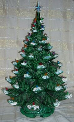 I have SO much love for ceramic Christmas Trees. They remind me of ...