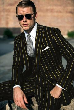 This 2 button suit features a bold pinstripe, 2 buttons, and a double breasted vest. Pinstripe Suit Women, Double Breasted Pinstripe Suit, Double Breasted Vest, Grey Suit Men, Mens Fashion Suits, Mens Suits, Man Fashion, Mens Italian Suits, Dress Suits For Men