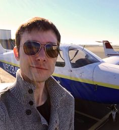 Photo of Tom in front of plane.