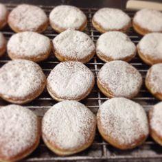 Powdered Sugar Lenon Filled Paczki for Mardi Gras. (Polish Donuts)