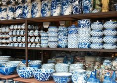 Thai made blue and white ceramic pottery for sale at Chatuchak Weekend Market in Bangkok, Thailand. / These items can be found at the local Chinatown market