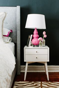 perfect white side table in front of my dark blue wall maybe accent yellow not pink!