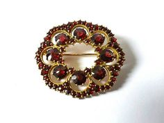 Check out this item in my Etsy shop https://www.etsy.com/listing/524392657/bohemian-vintage-czech-garnets-flower