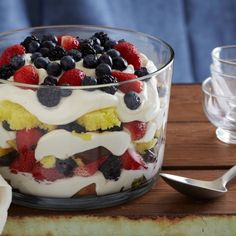 Lemon Curd Trifle with Fresh Berries - my go-to easy summer dessert for a crowd. I use angel food cake instead of pound, more berries than the recipe calls for (usually add raspberries too) & like cointreau or grand marnier Lemon Desserts, Köstliche Desserts, Summer Desserts, Delicious Desserts, Sweet Desserts, Awesome Desserts, Summer Cakes, Summer Treats, Yummy Food