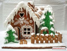 I like the trees covered in green coconut on this gingerbread house.