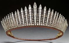 Also known as The George III Tiara, the Russian Fringe tiara was made in 1830 as a necklace from brilliant cut stones that belonged to King George III. Queen Victoria wore it as a tiara on an official visit to the opera in 1839. It was inherited by Queen ...