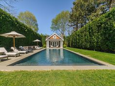 Trisha Troutz: Hamptons Houses No. 21  plantings around pool, pool house at end, steps in at nearest end.