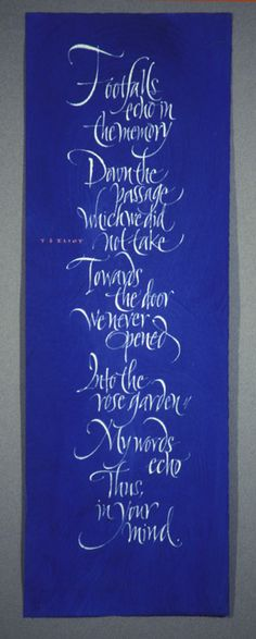 On the door...cool!  Footfalls echo in the memory, TS Elliot quote. Calligraphy by John Stevens
