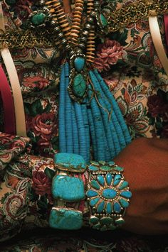 Turquoise Jewelry - IH136827 - Rights Managed - Stock Photo - Corbis Turquoise jewelry adorns hand and neck of a person at the Indian Cultural Center in Albuquerque, New Mexico.