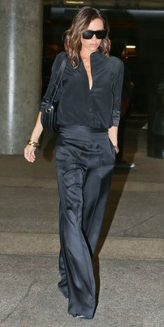 Jet-setting style star Victoria Beckham pieced together another one of her posh ensembles—this time, creating a fluid shape with a relaxed blouse tucked into a pair of satiny wide-leg pants.