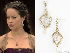 """In the episode 2x05 (""""Blood for Blood"""") Lady Lola wears these Nina 'Arizona' Open Drop Earrings. You can find them in color ivory/silver here for $65."""