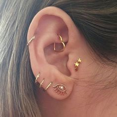 Daith Piercing And Cartilage Spiral Piercing on Left Ear
