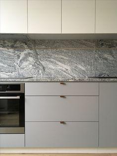 Gray white kitchen. Granite countertop. Cooper adds