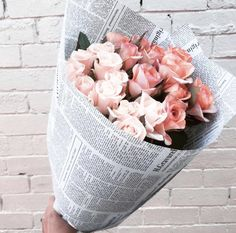 Bouquet of flowers in newspaper