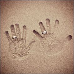 Show off your rings on your sand hands-- cool wedding photo, but also really cool for an engagement announcement