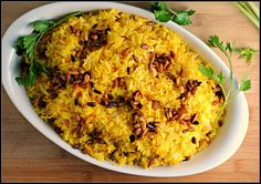 Saffron Rice with Golden Raisins and Pine Nuts--made this tonight to go with seasoned pork chops and it was AWESOME!  Really flavorful but accessible.  Will make again for sure :-)