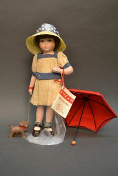 """Bessie Pease Gutmann, Illustrator, """"He Won't Bite"""", collectible doll, by The Hamilton Collection, circa unknown."""