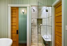 Sparkling shower with glass door steals the show in this brilliant bath 25 Glass Shower Doors for a Truly Modern Bath