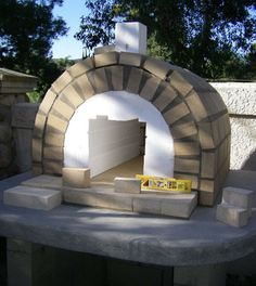 Second layer of tan firebrick on the Wood-Fired Brick Pizza Oven foam form - BrickWood Ovens