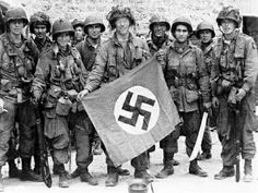 Paratrooper Of Us Airborne Division Holding A German Flag Captured In A Village Near Utah Beach Saint Marcouf France 8 Jun Us Army Center Of