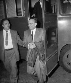 Mob Boss Vito Genovese, handcuffed and going to prison after his conviction on a bogus drug charge. Genovese was framed by his fellow Mafia bosses, and he subsequently died in prison.