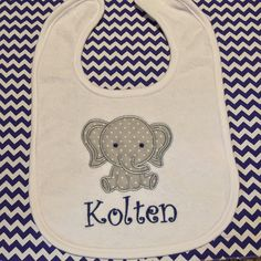 A personal favorite from my Etsy shop https://www.etsy.com/listing/240686070/personalized-bib-with-elephant-applique