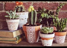 Lace Covered flower pots - could also spray paint and remove lace leaving pattern