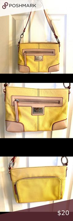 Tignanello small crossbody bag. Tignanello small crossbody bag, yellow. Lots of pockets on the inside and outside, including a built in wallet. Approximately 10.5 x 8 inches with a 20.5 inch drop if fully extended. Great condition from a smoke free home Tignanello Bags Crossbody Bags Small Crossbody Bag, Smoke Free, Drop, Pockets, Shoulder Bag, Wallet, Yellow, Closet, Things To Sell