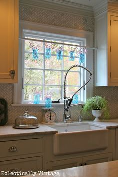 Mason Jar Window Treatment. Clever idea to first paint the Mason Jars then hang them above the kitchen sink from a shower curtain tension rod placed between the kitchen cabinets.  Fill the jars and enjoy!