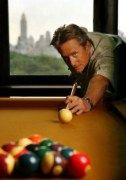 Michael Douglas playing pool in his New York apartment overlooking the park