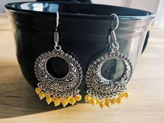 Check out this item in my Etsy shop https://www.etsy.com/listing/522402529/yellow-indofusion-silver-jhumka-earrings