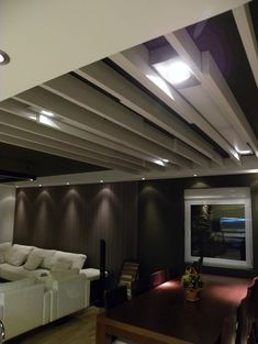 Great for basement - top black, beams white with lighting boxes in between and lots of pin lights to bring lightness to dark corners...