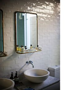 shiny subway tiles. vintage brass mirror