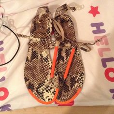 DV Dolce Vita Snakeskin Archer Sandals Cute Dolce Vita snakeskin archer sandals with neon orange bar thong style snakeskin design and only worn twice I love these to death but they just don't fit me!!! Kind of dusty at the bottom NOT BRAND NEW BUT IN GOOD CONDITION Dolce Vita Shoes Sandals