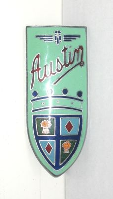 Austin A90 Atlantic Car Badge - A90 Atlantic 1948-1952 2660cc.  Beautiful badge with many colours of enamel, mounted below the Austin Winged Wheel badge. This one is new old stock. Marked Ming Ware Ltd B'ham.