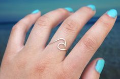 This is a wire ring in the shape of a single ocean wave! A perfect ring to show your love for summer and water! (This listing is for one ring). You could also wear multiple wave rings at a time to cre