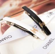 gold logo hair clip