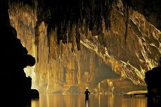 John Spies explores the Tham Lod cave in Pang Mapha, Thailand