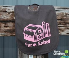 FARM RAISED, boy or girl Infant Reversible Bib with barn image