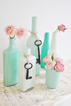 DIY from Pink Pistachio: repurpose empty jars and bottles into pretty bud vases for spring! Tells you paint colors to use.