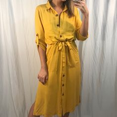 Havana Dress Havana Oh Na Na, Half of my heart is in this dress! -Mustard Yellow -Button-down Center -Collar -Three-Quartered Sleeve with button to cuff -Drawstring waist to tie -Midi Dress Model is wearing a Small Mustard Yellow, Havana, Drawstring Waist, Casual, Collars, Shirt Dress, Sleeves, Model, How To Wear