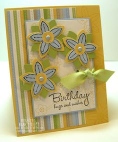 """STAMPS: Polka Dot Punches (SAB '09), Hugs & Wishes. PAPER: Delicate Dots DSP (SAB '09), So Saffron, Bashful Blue, and Certainly Celery CS. INK: Basic Black, Versamark. EMBELLISHMENTS: 5/8"""" Certainly Celery Poly-Twill Ribbon (SAB '09), Bashful Blue Brads. TOOLS: 5-Petal Flower Punch, 1/2"""" Circle Punch, Horizontal Slot Punch. OTHER: Stampin' Dimensionals."""