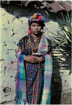 Child in ceremonial clothing.