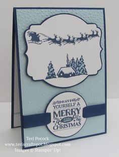 handmade Christmas card by Teri Pocock ... Cozy Christmas with Curvy Corner Trio Punch ... navy, light blue and white ... Santa and sleigh ... luv the sentiment circle attached with a slider ribbon wrap ... Stampin' Up!