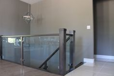 10mm clear tempered glass stair railing with Brushed Nickel glass clamps grandriverglass.com